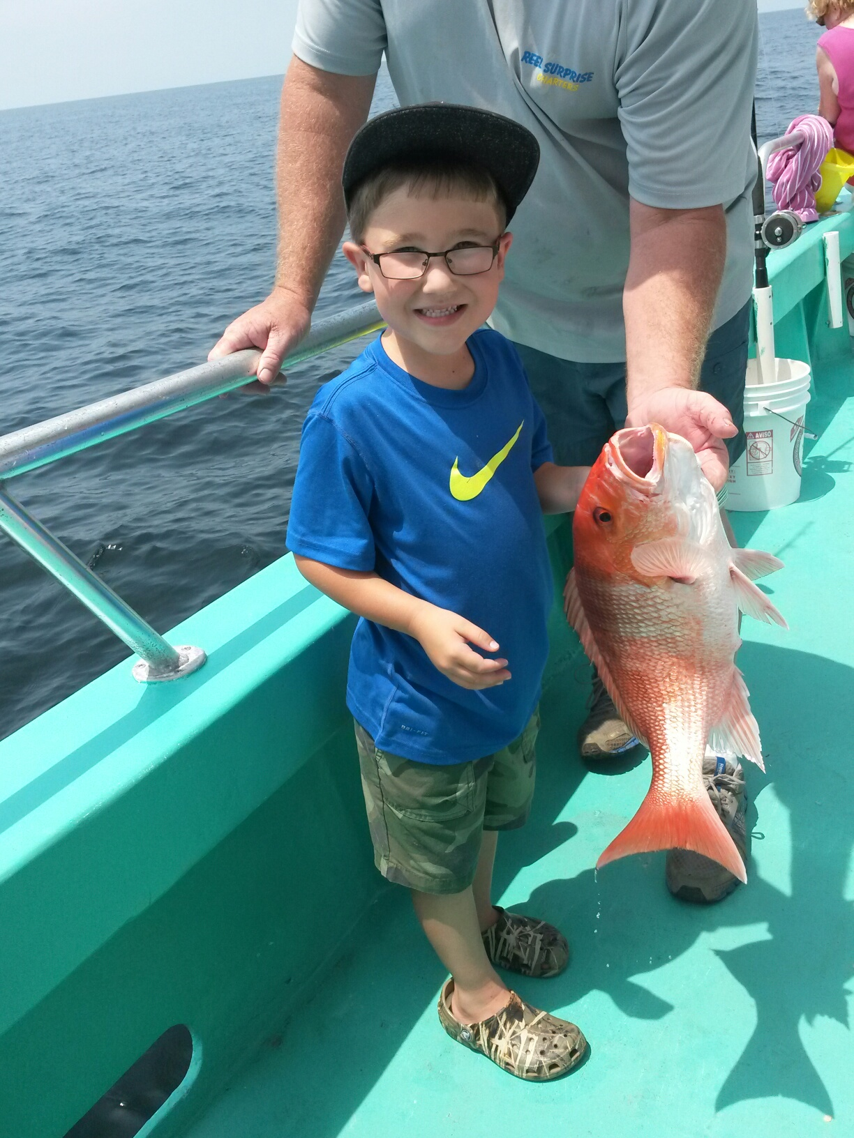 https://alabama-travel.s3.amazonaws.com/partners-uploads/photo/image/54efbd34f1db87a69100002c/deep_sea_fishing_alabama_big_smile_boy_with_his_red_snapper.jpg