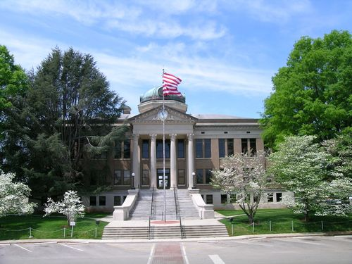 Slide_athens_courthouse_with_flag_and_dogwoods