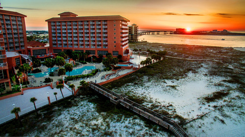 Slide_sunrise_at_perdido_beach_pool_and_walkway_revised