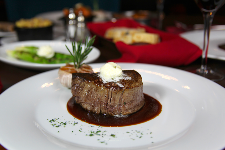 https://alabama-travel.s3.amazonaws.com/partners-uploads/photo/image/59c3ea42c3252cc33400005d/steak_entree_at_fire.png