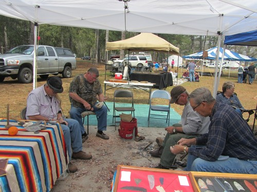 Slide_knappers_sit_in_a_circle_so_they_can_converse_while_knapping___not_unlike_ancient_stone_toolmakers_may_have_done_it