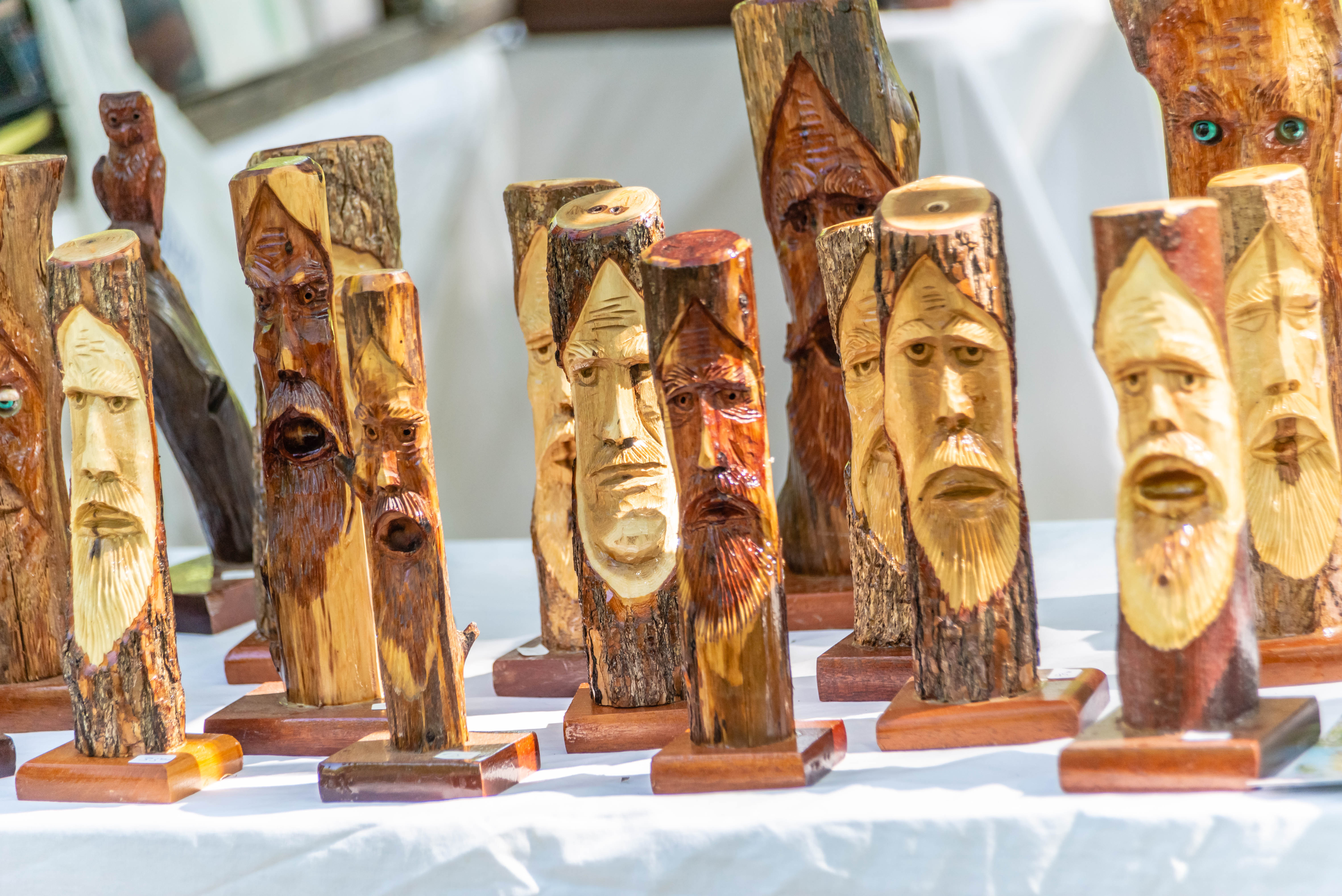 https://alabama-travel.s3.amazonaws.com/partners-uploads/photo/image/5b68b77bd2f36b2ae1000035/miniature_tinglewood_trees__carved_by_tim_tingle__will_be_offered_for_sale_at_the_festival.jpg