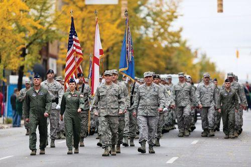 Slide_birminghamveteransdayparadesoldierswithflags