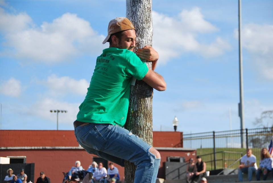 https://alabama-travel.s3.amazonaws.com/partners-uploads/photo/image/5f21a2ac05d11e0007a67543/Opp Rattlesnake Rodeo Greasy Pole Climbing Contest.jpg