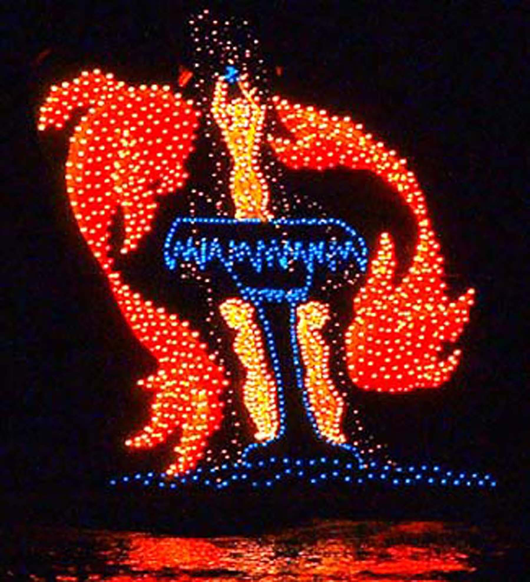 https://alabama-travel.s3.amazonaws.com/partners-uploads/photo/image/5f2841691153950008a3fa2f/COTR Night Parade - fountain float.jpg