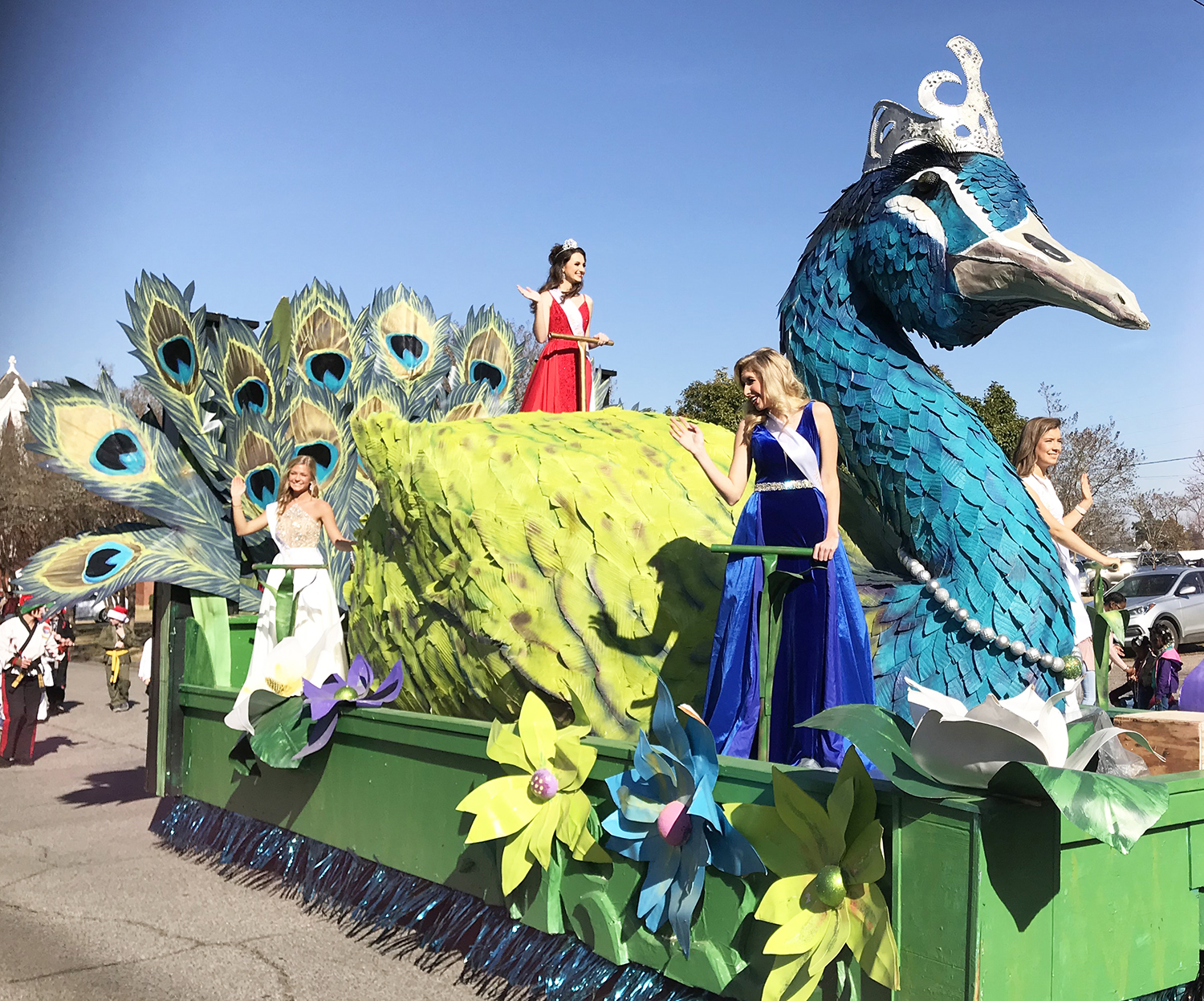 https://alabama-travel.s3.amazonaws.com/partners-uploads/photo/image/5f28416942c80e0007d316e8/COTR Day Parade - peacock float.jpg