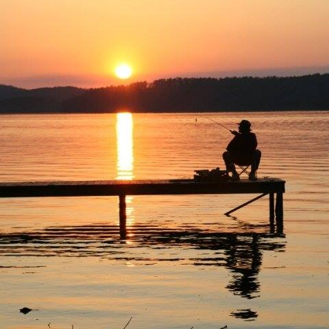 https://alabama-travel.s3.amazonaws.com/partners-uploads/photo/image/5fcfdbaa30a09d0007929ba1/fisherman.jpg