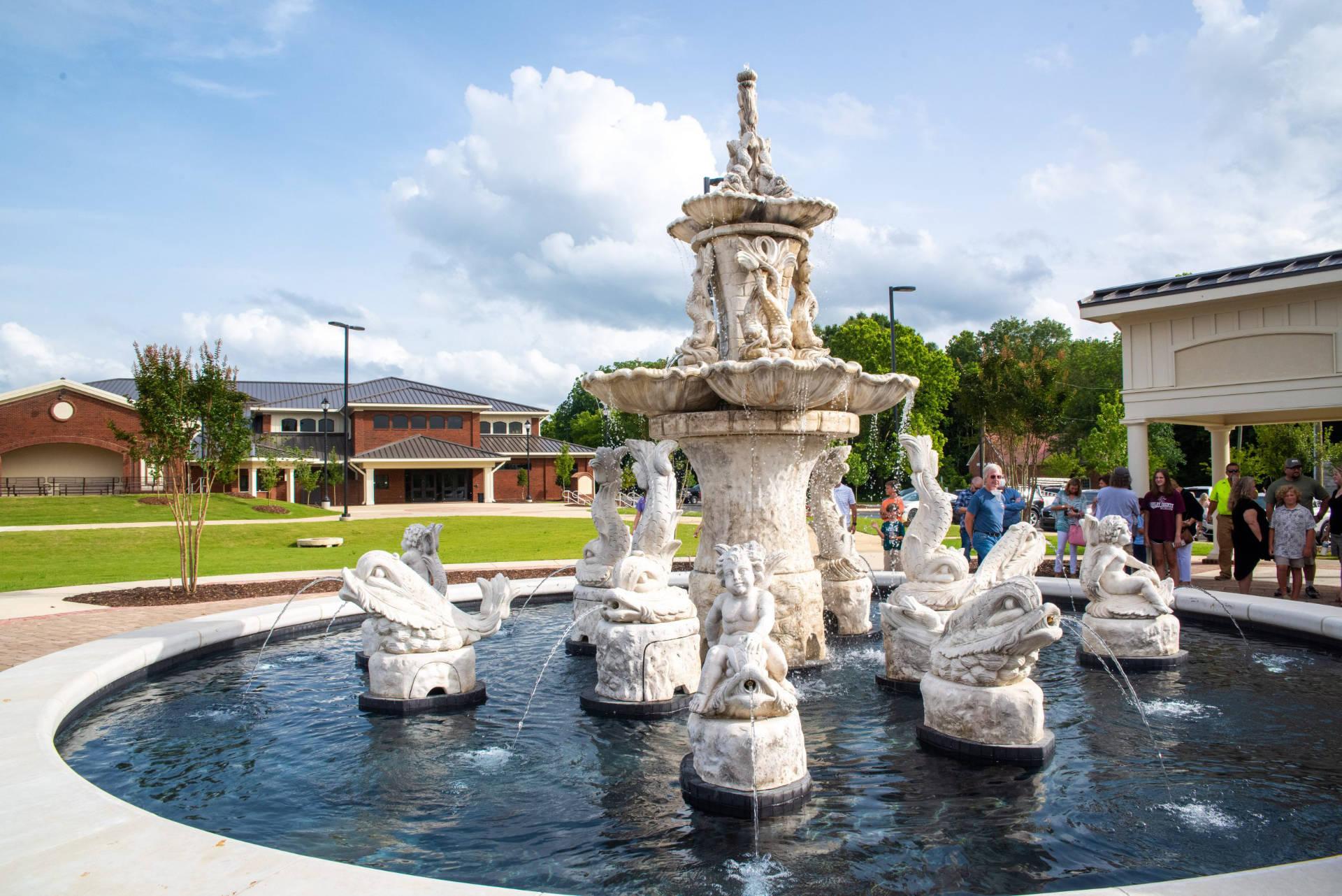 https://alabama-travel.s3.amazonaws.com/partners-uploads/photo/image/6095f1029068320008af1b59/Old-Mill-Square-Columbiana-Shelby-County-Alabama-Colonnade-Fountain-Plaza-Premiere.jpg